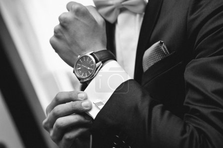 Photo for Close up of elegant man in suit with watch on hand - Royalty Free Image
