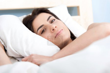Young beautiful woman sleeping in bed