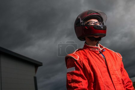 Race car driver wearing protective helmet