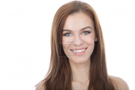 Head and shoulders studio portrait of a smiling woman. Isolated