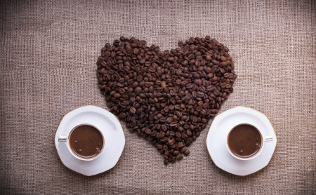 Photo for Heart shaped coffee beans with coffee cups. Turkish coffee - Royalty Free Image