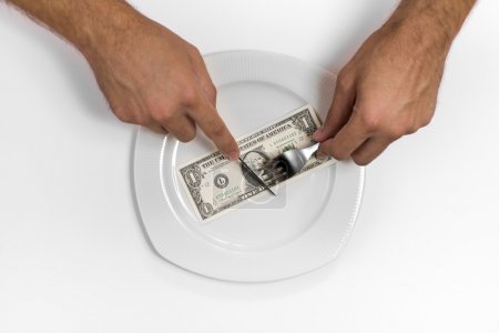 Photo for Single one dollar bill on the middle of a plate, knife and fork. - Royalty Free Image