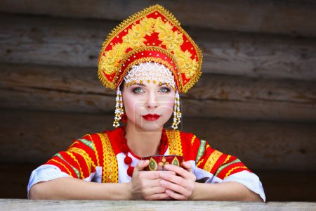 Photo for Russian girl drinking tea in the village - Royalty Free Image