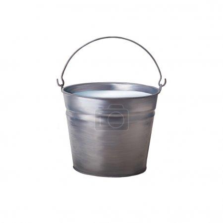 Metallic bucket with milk isolated on white background