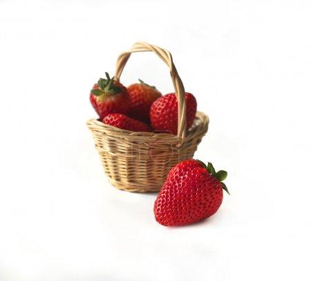 Strawberries in a little wicker basket