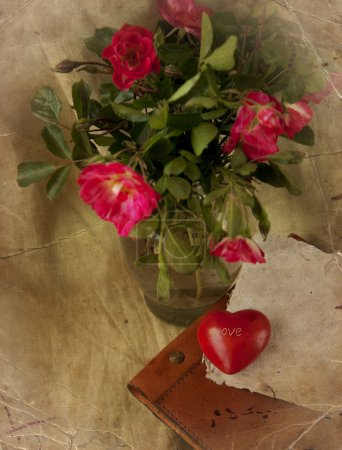 Red roses, heart and old book