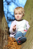 Girl sitting between the branches