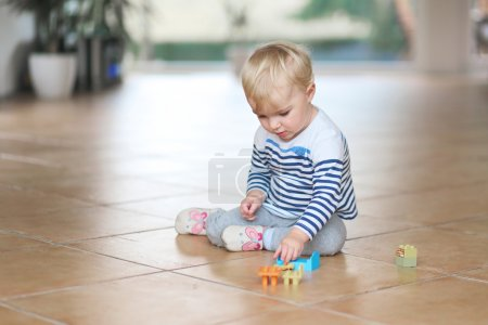 Baby girl play with plastic bricks