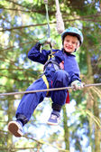 Teenager school boy climbing
