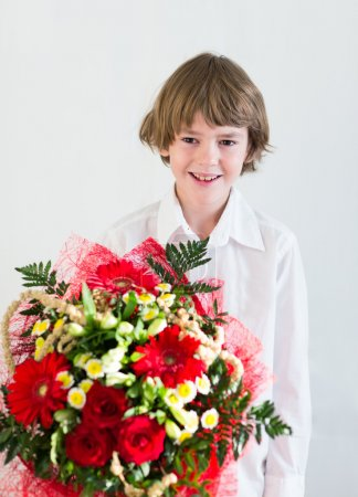 Boy with colorful bouquet flowers