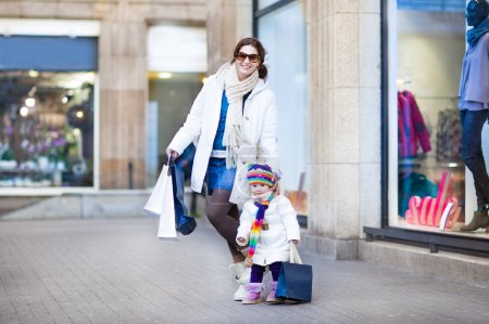 Mother and her toddler daughter enjoying shopping