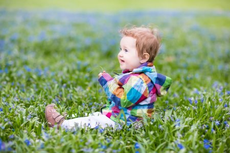 Adorable baby girl playing in a garden