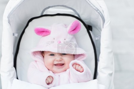 Funny baby girl wearing  bunny snow suit