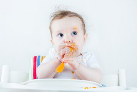 Baby eating a carrot