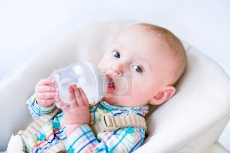 Baby boy drinking milk