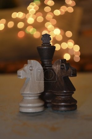 Two chess horses protect the King