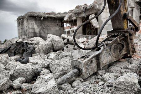 Demolition of old derelict buildings with jackhammer