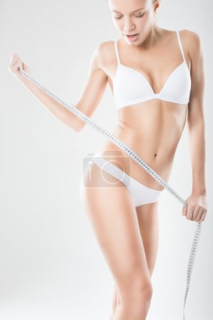 Woman Measuring Her Perfect Body. Healthy lifestyle concept .Die