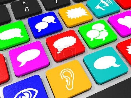 Social media symbols key on keyboard of laptop computer.
