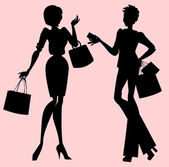 Silhouettes of women during shopping
