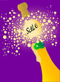 Champagne bottle being opened with froth and bubbles with a large bubble with a sale notice