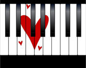 Black and white piano keys with a large love heart within the keys