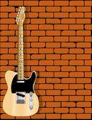 An electric guitar against a brick wall