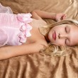 Beautiful little girl sleeping on bed. Girl is wea...