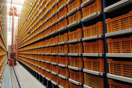 Inside a warehouse with yellow shelves