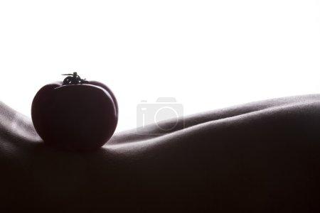 Tomato on woman skin
