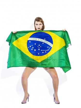 Sensual football supporter holding Brazil flag and looking