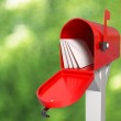 Very high resolution 3D rendering of an open mailbox with some letters inside.