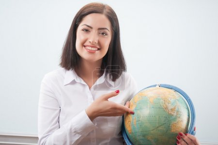 Business woman with the globe