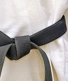 Karate Schwarzgurt weiße Uniform