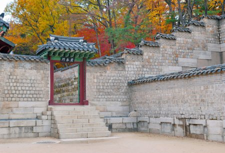 Traditional Architecture with Entrance and Wall in Autumn Foliage. Changgyeonggung Palace, Seoul, South Korea