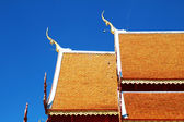 Wooden Thai style roof texture with sky