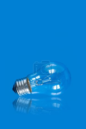 lightbulb on blue background with reflection