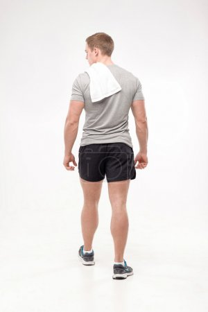 Man after workout with towel