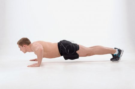 Guy making push ups exercise