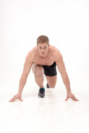 Man athlete doing running exercises