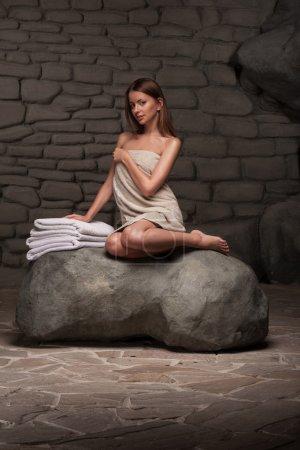 Woman relaxing in spa resort
