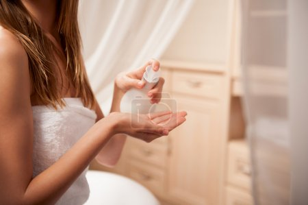 Young woman holding a soap container