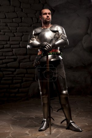 Medieval Knight posing with sword