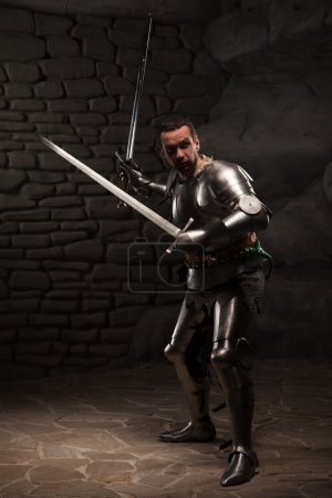 Medieval Knight posing with two swords