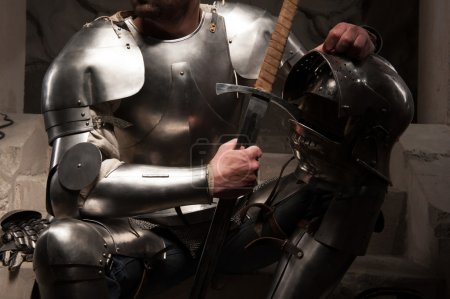 Knight in armor with helmet and sword