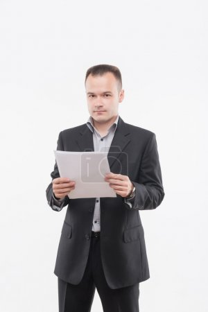 Young businessman with papers