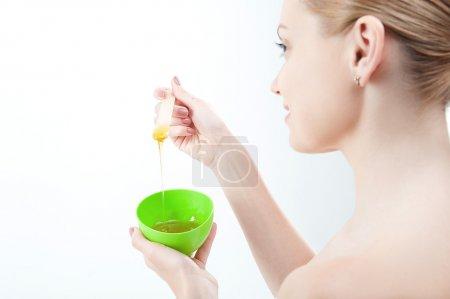 Woman preparing  homemade  facial mask of honey