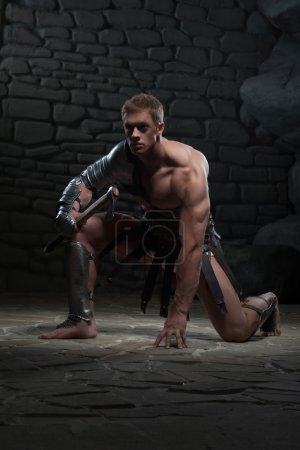 Gladiator with axe kneeling