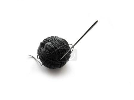 Ball of yarn and needle