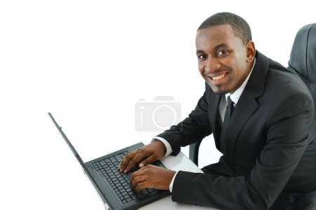 Businessman with laptop sitting at desk